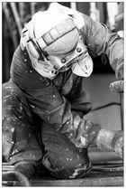 DQVK 100 (a) Men at Work