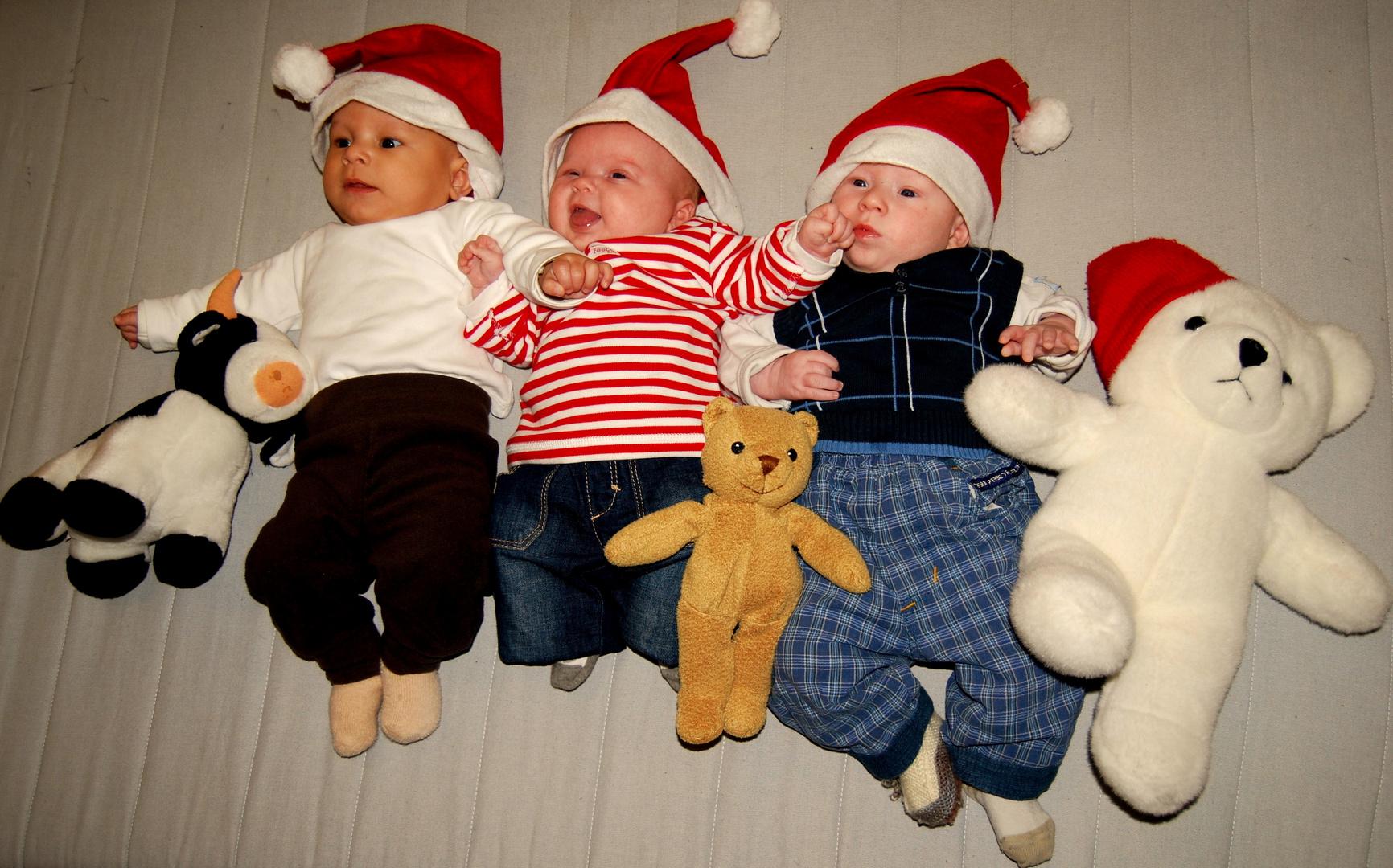 Drei kleine Weihnachtsmänner