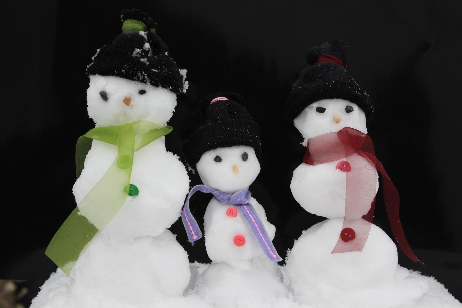 Drei Männer aus Schnee