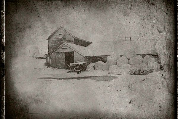Farmhouse with Hay Rounds