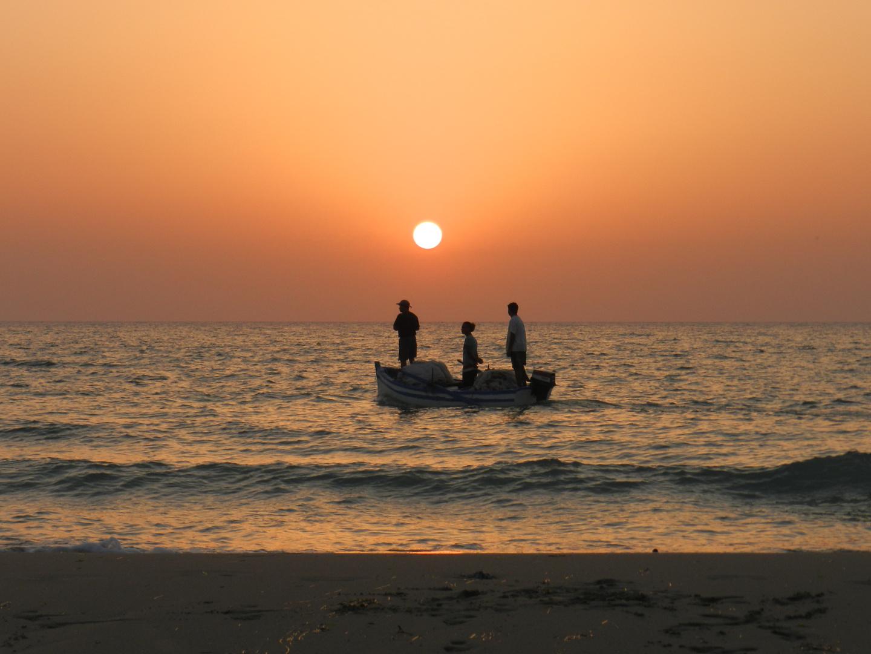 Fischer am Sonnenaufgang