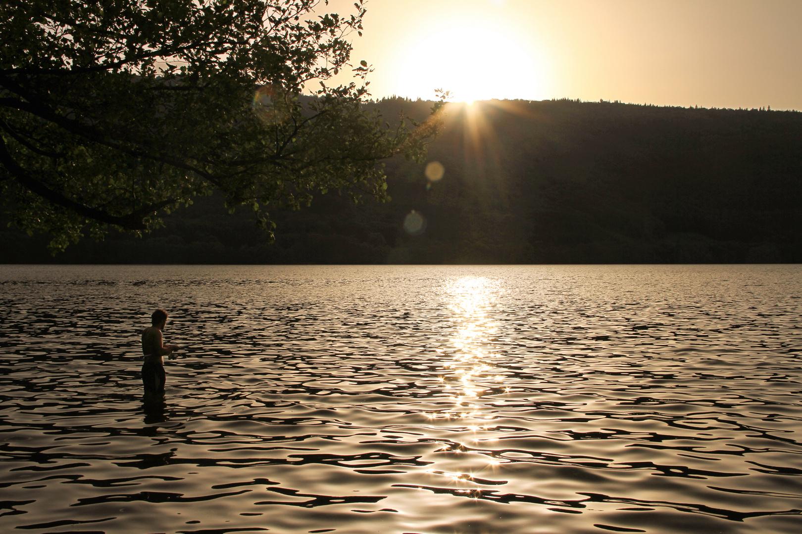 Fischer im Abendlicht