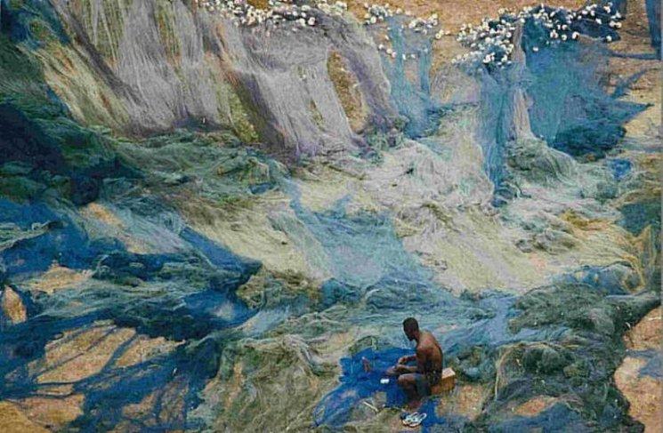 Fischer im wogenden Netz