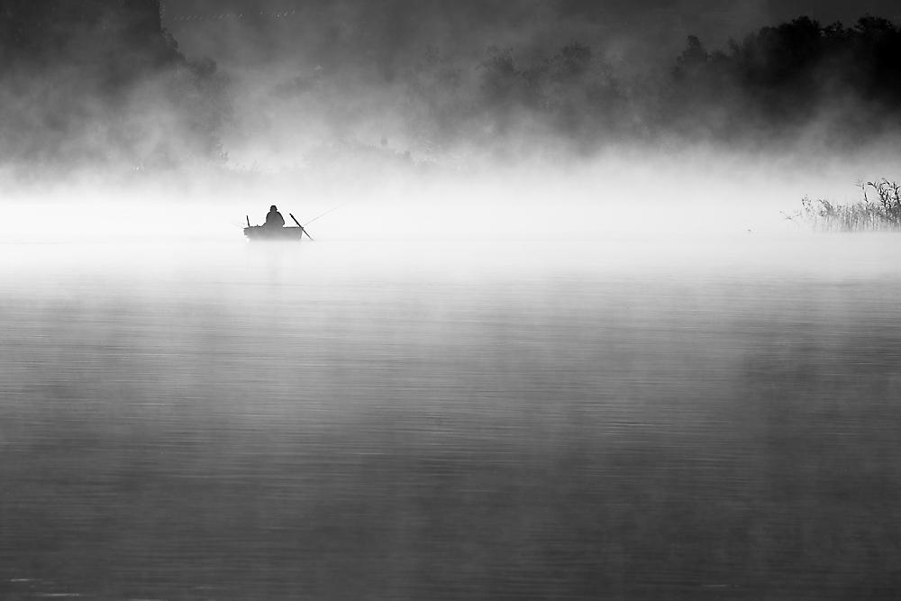 fisherman and fog