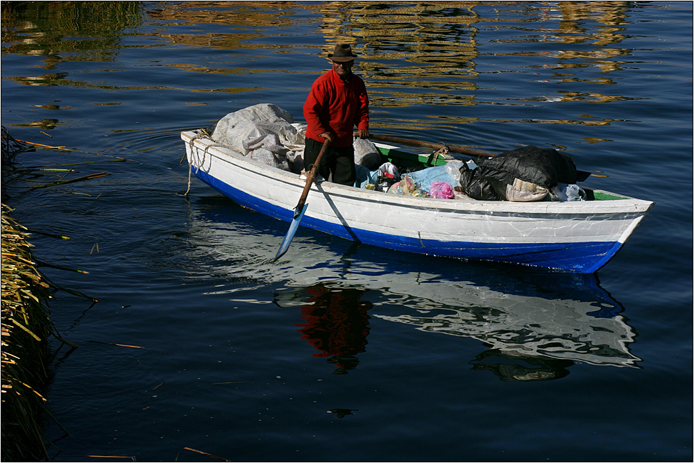 fisherman at titicaca lake