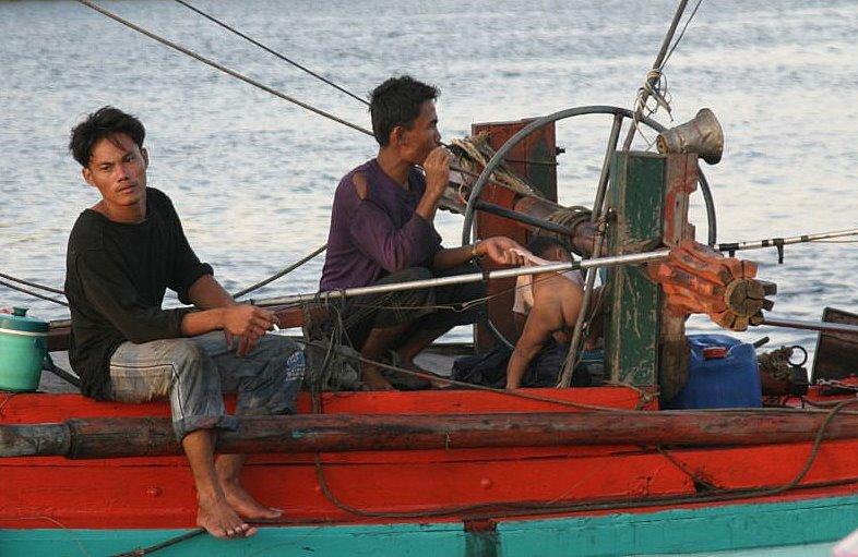 Fishermen and family