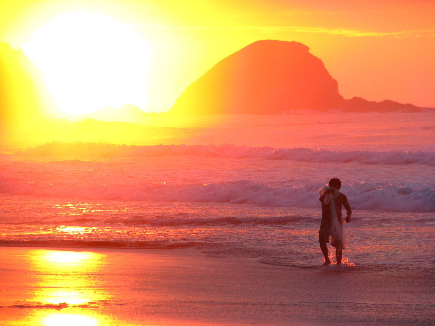 fishermen at work during sunrise at Mexican pacific coast