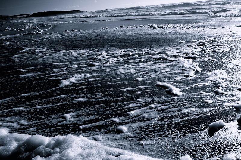Foam on blue beach