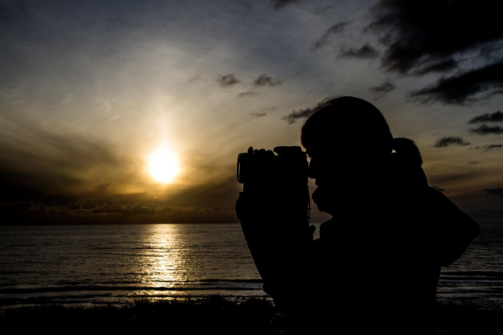 Fotograf im Sonnenuntergang