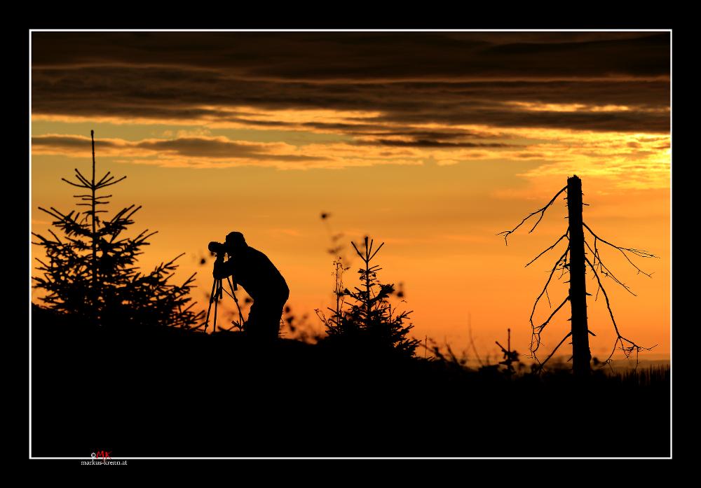 Fotograf in der Morgendämmerung