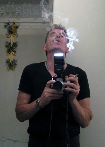 fotografierendes Tabakgesicht