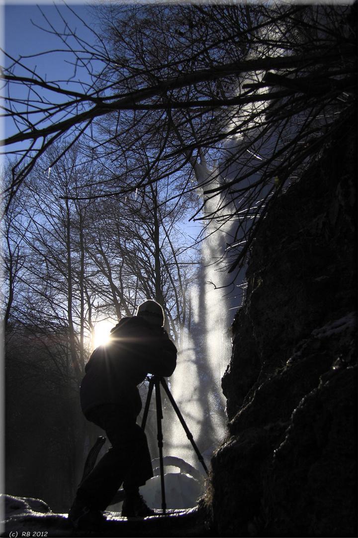 Fotograf(in) bei der Arbeit