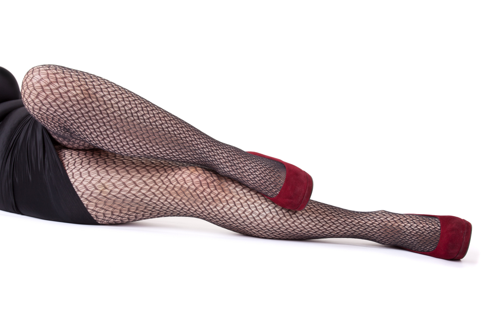 Frauenbeine in roten Schuhen