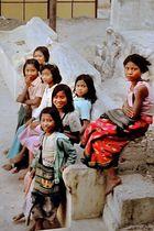 Girls at the stairways to Taung Kalat