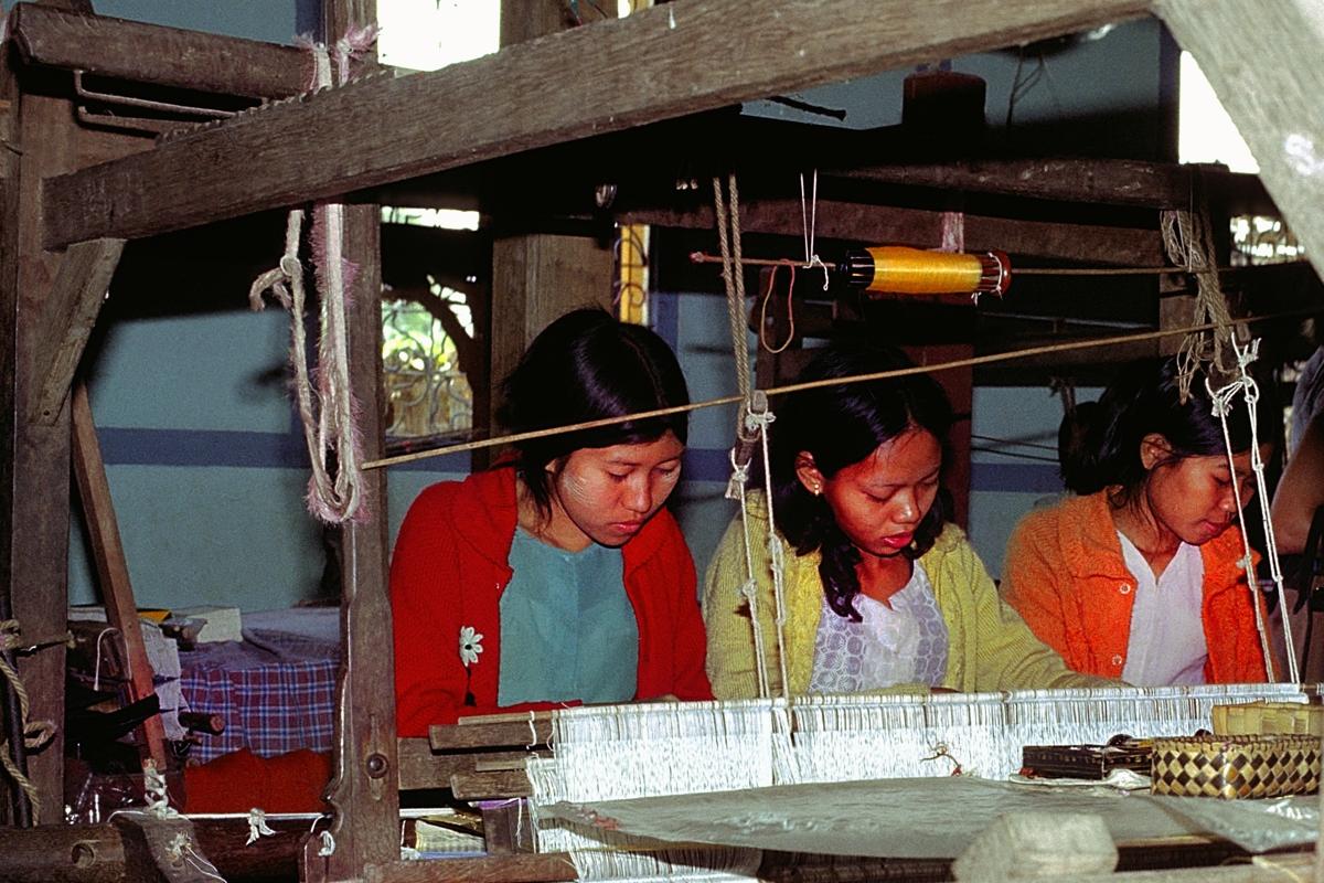 Girls working on a loom