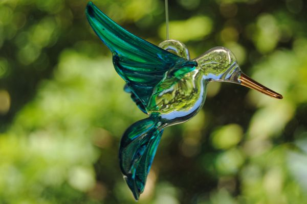 Glass bird on a green background