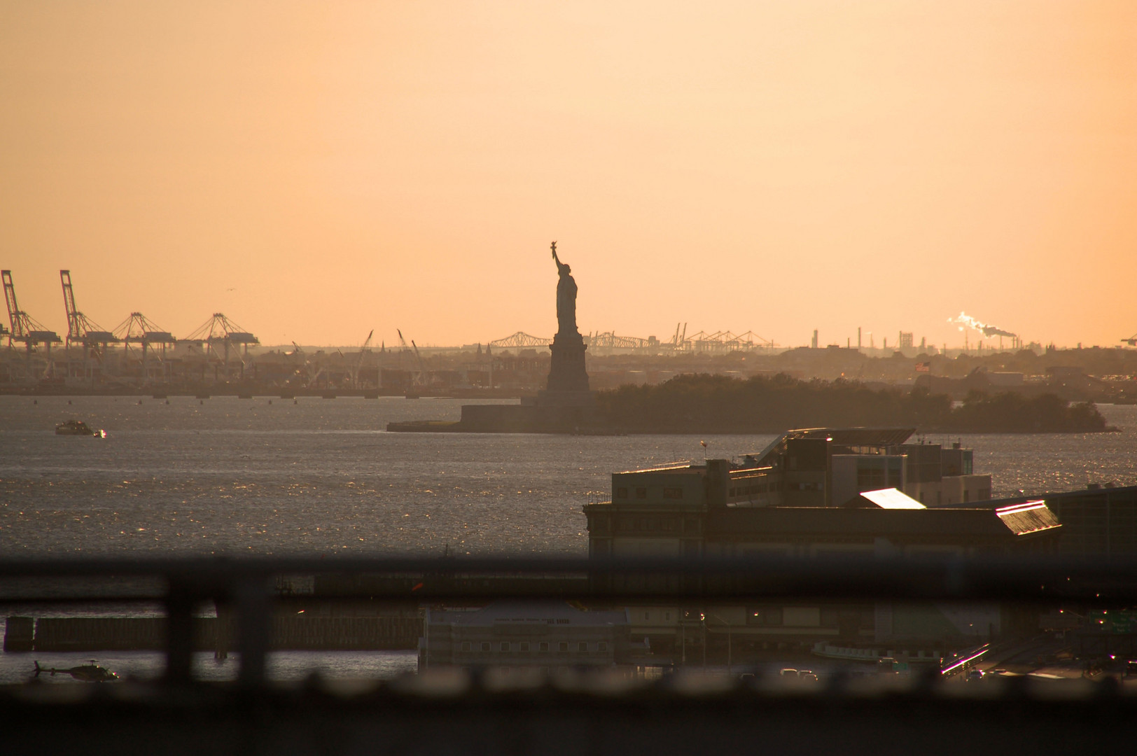 golden hour NYC statue of liberty