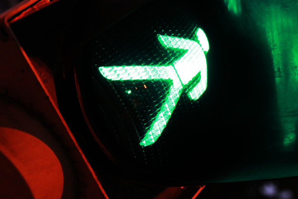 green man walks to red light