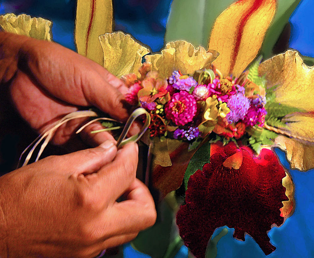 Hands of a lei maker