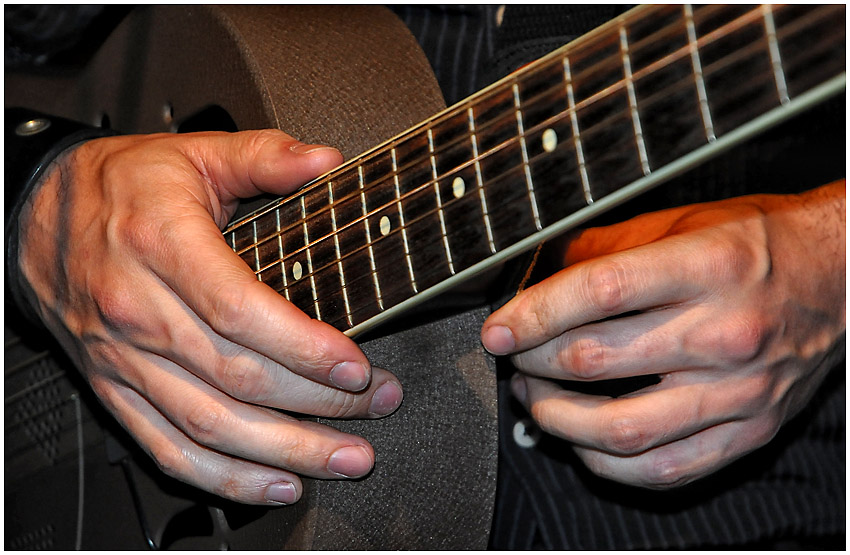...hands on guitar...