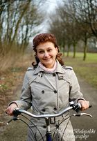 Happy Woman on a Bicycle