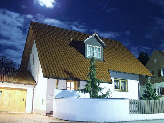 Haus bei Mondlicht