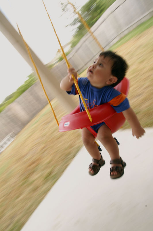 ...his first ride on the swing.