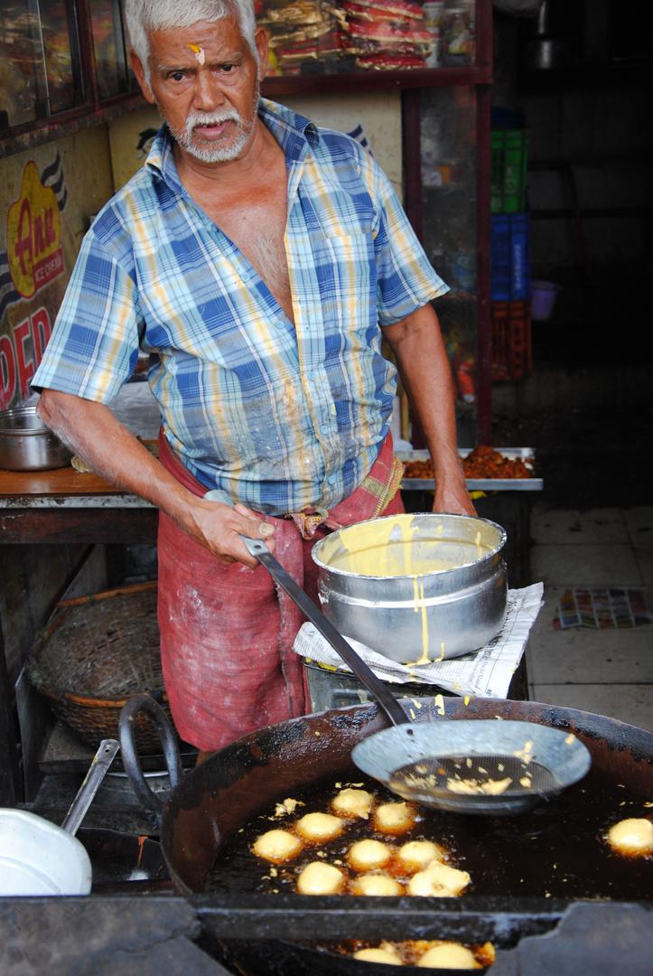 Indian Man at Street Kitchen