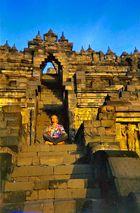 "Indonesia, Java ""Photographer - Praying at Borobodur"""
