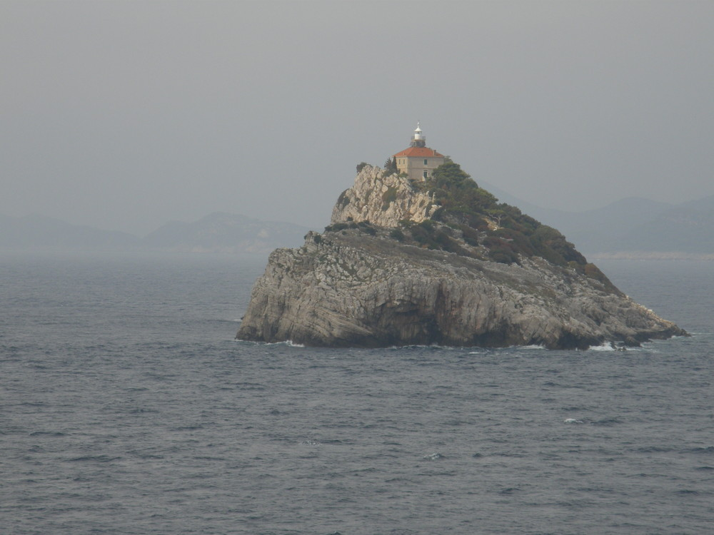 Isla Croata con faro. Isolated Croatia island.