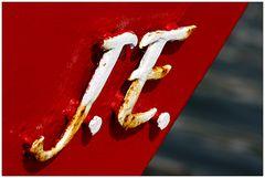 J. E.