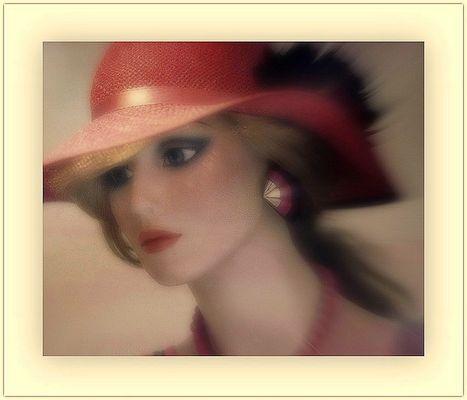 Jeune femme au chapeau rouge