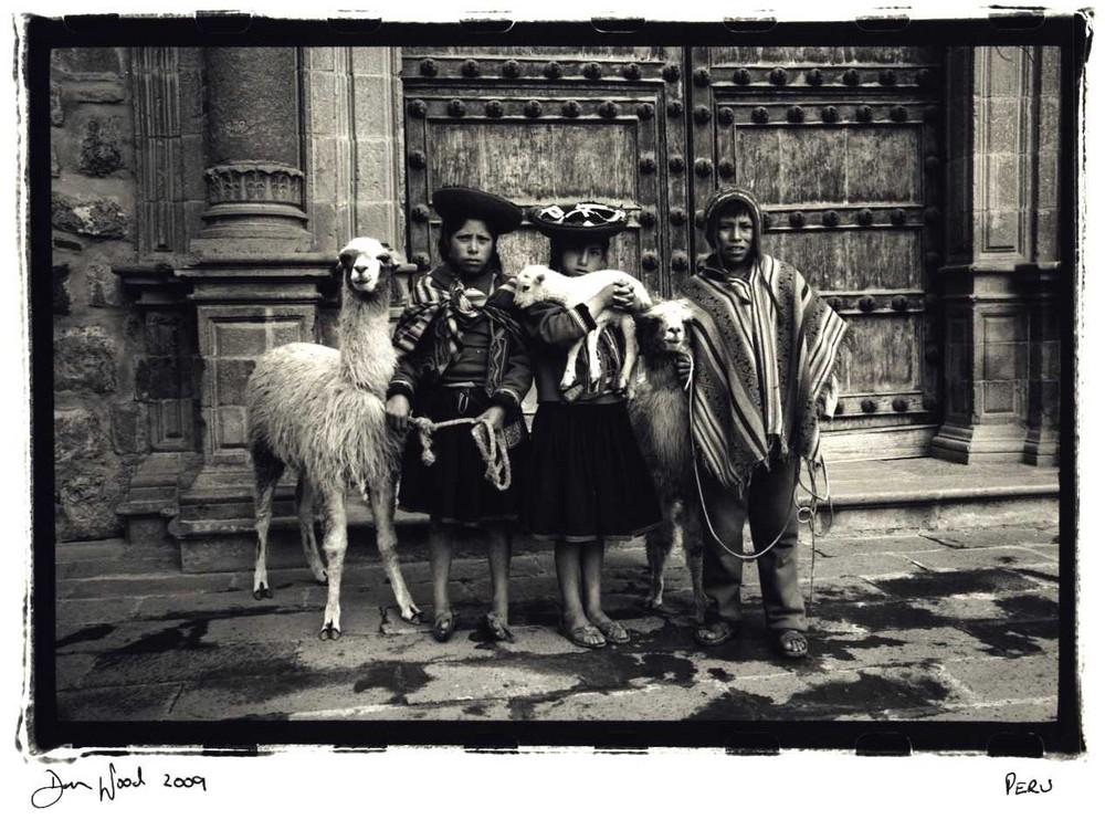 Kids with lamas,Peru