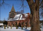 Kirchhof im Schnee