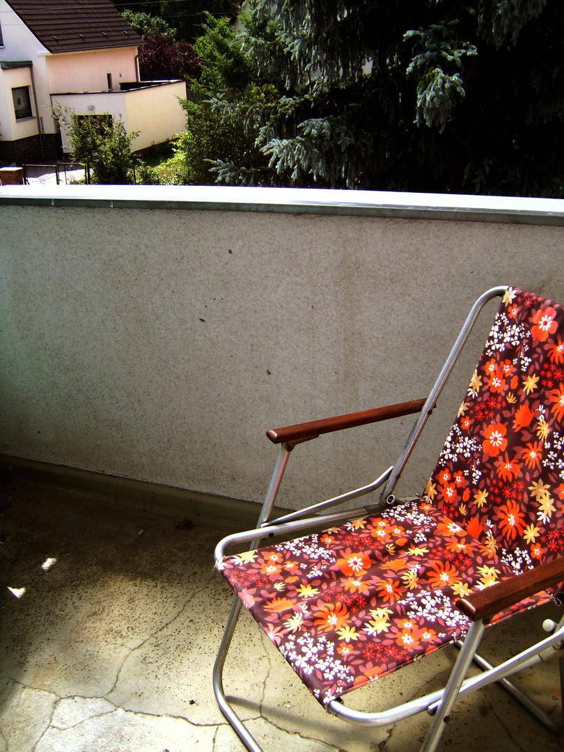 Klappstuhl auf dem Balkon
