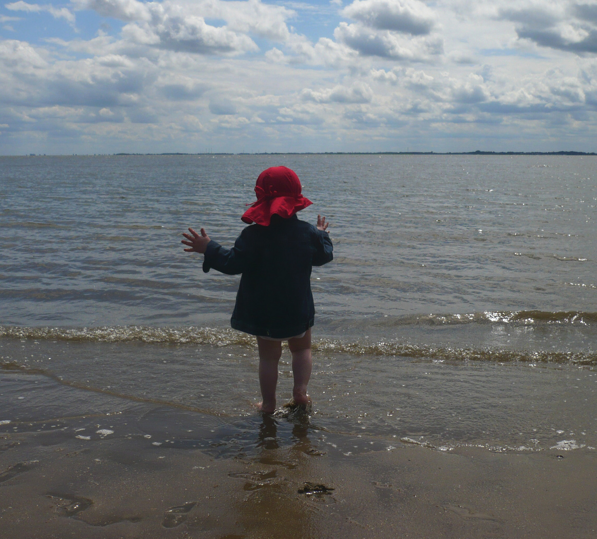 kleiner Mensch am Meer