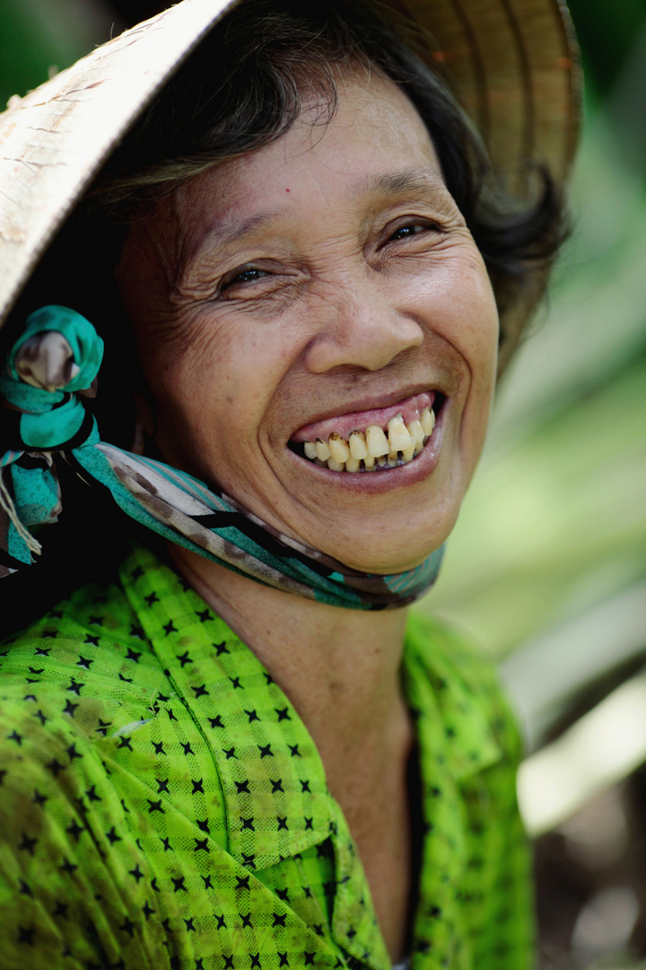 Laughing woman in the rice field.