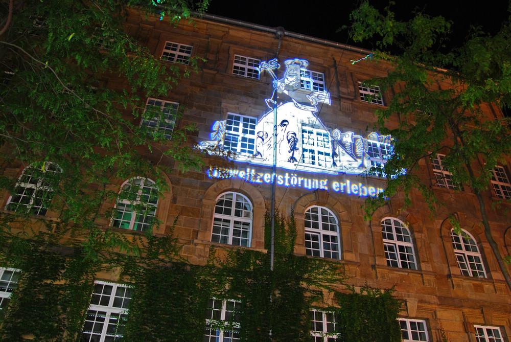 Lichtkunstprojektion Rathaus Kassel Karikatur K+S AG