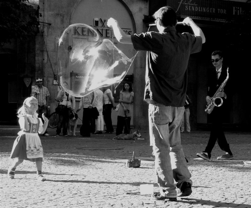 little girl with a bubble, bubble-maker and a sax player