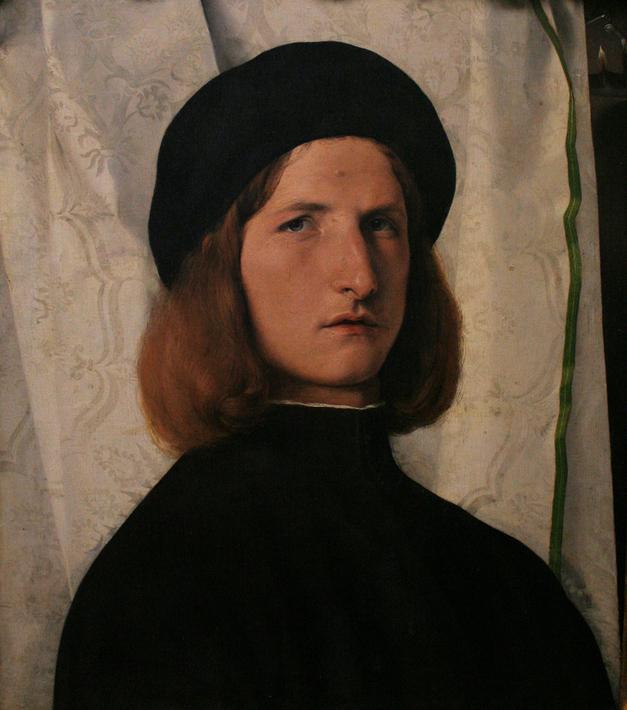Lorenzo Lotto: Junger Mann vor weißem Vorhang