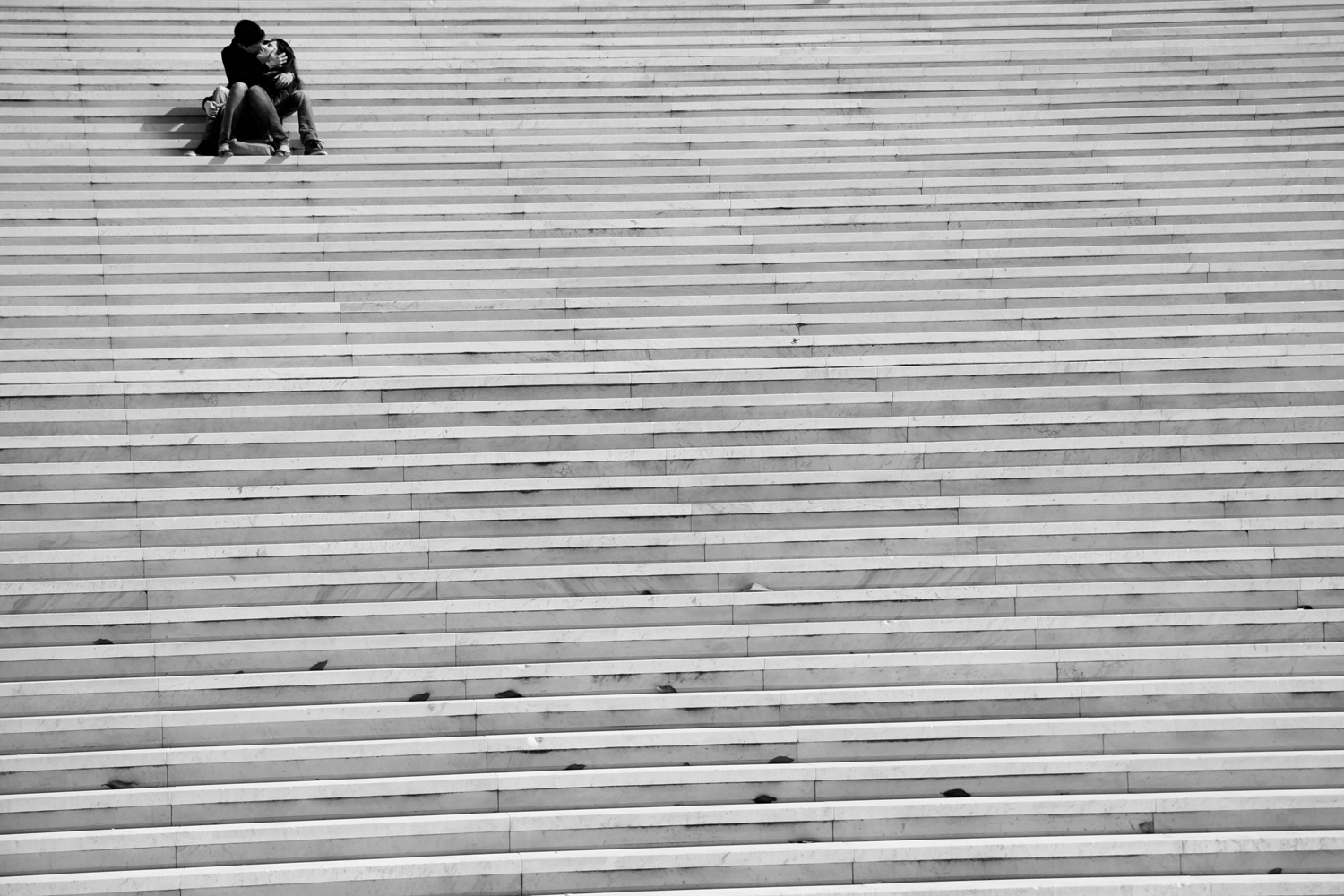Loving couple on the stairs