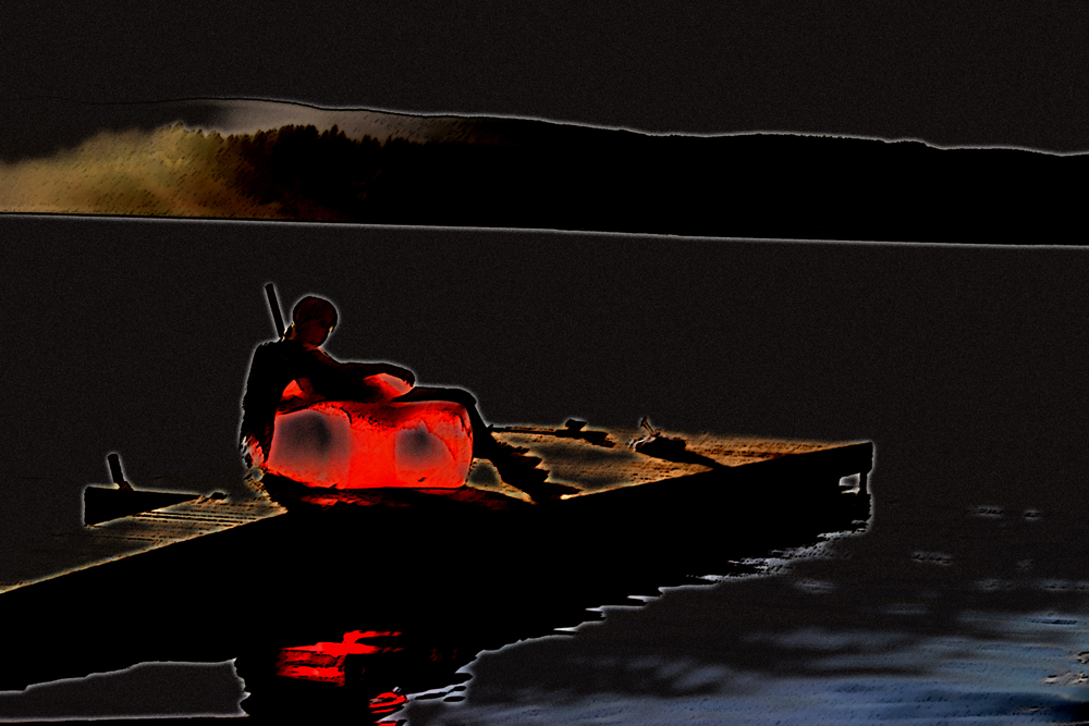 Mädchen im roten Sessel am See