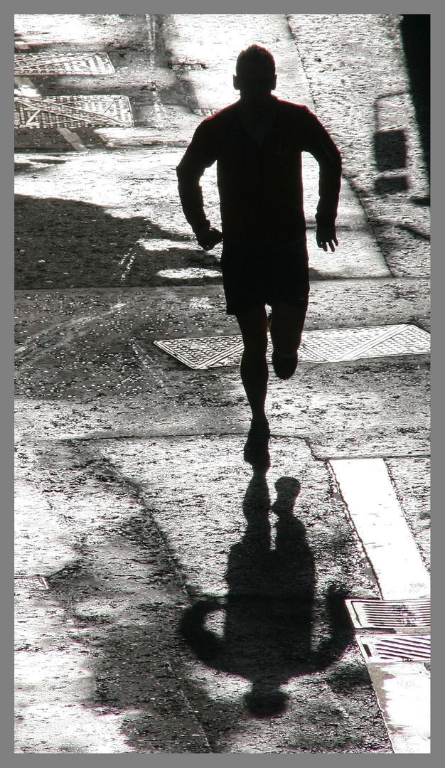 man running near the barbican London