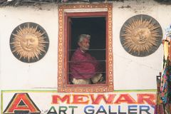 man sitting in ART Gallery, India, Rajasthan