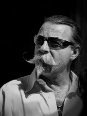 Man with a mustache and  in sunglasses