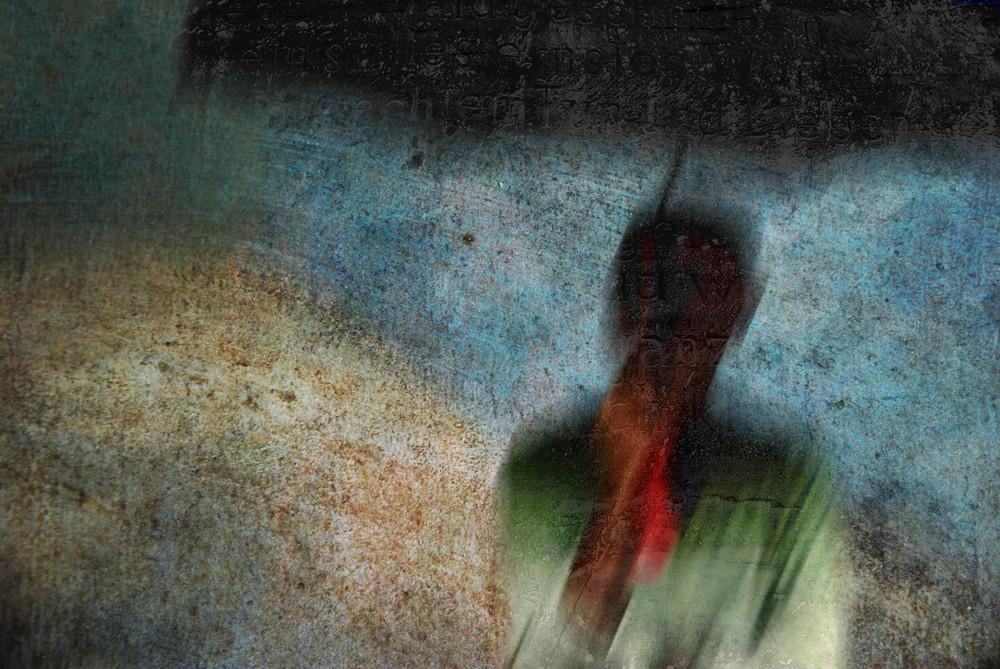 Mann im Regen