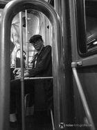Mann in Strassenbahn / Man in Train