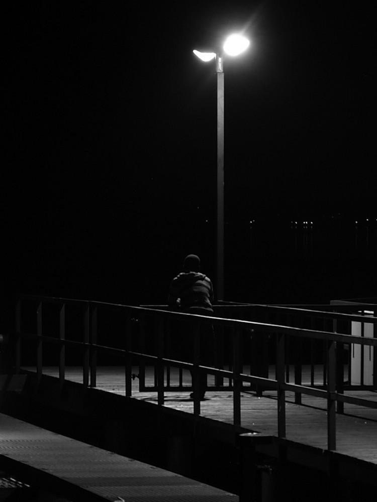 Mann unter der Laterne