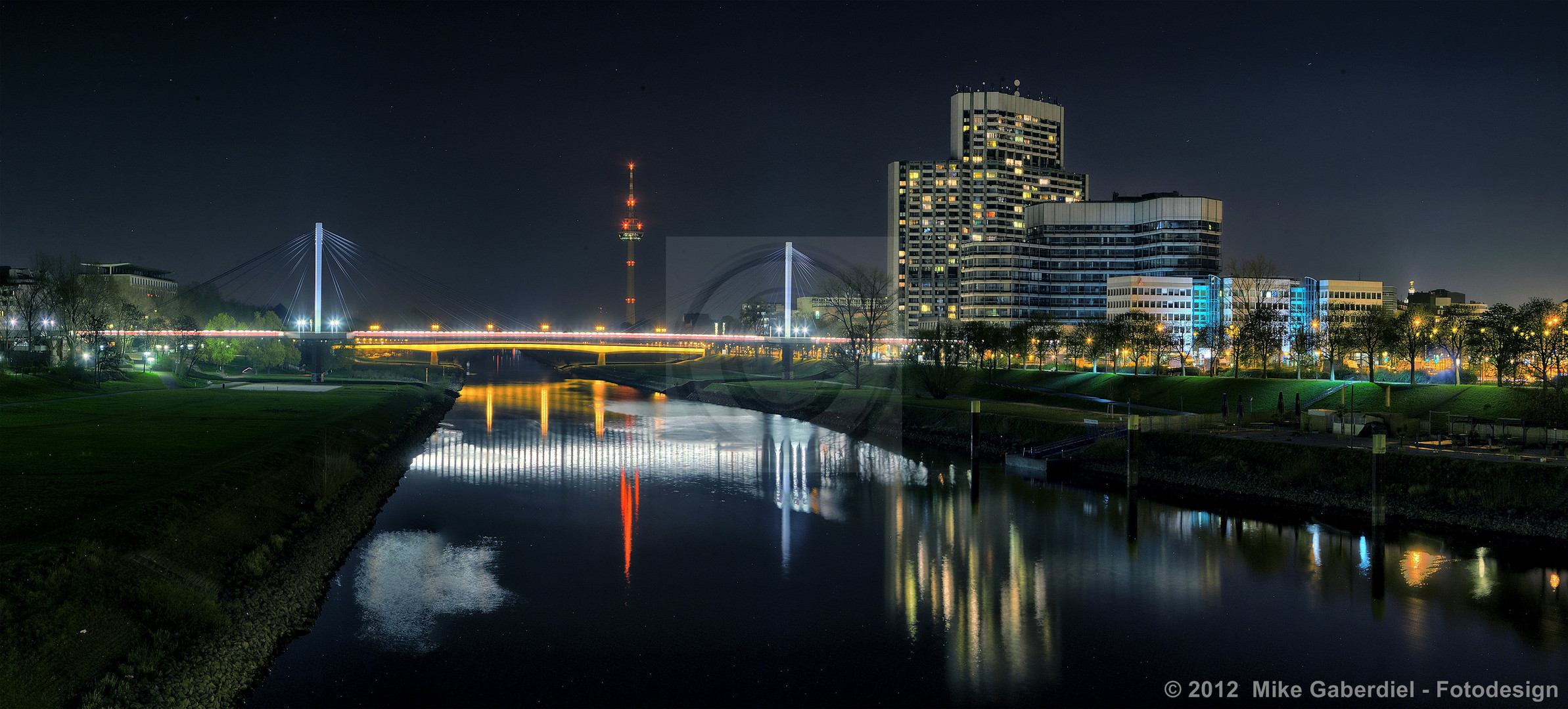 Mannheim, Germany, Night view of the Neckar with TV Tower and Collini Center