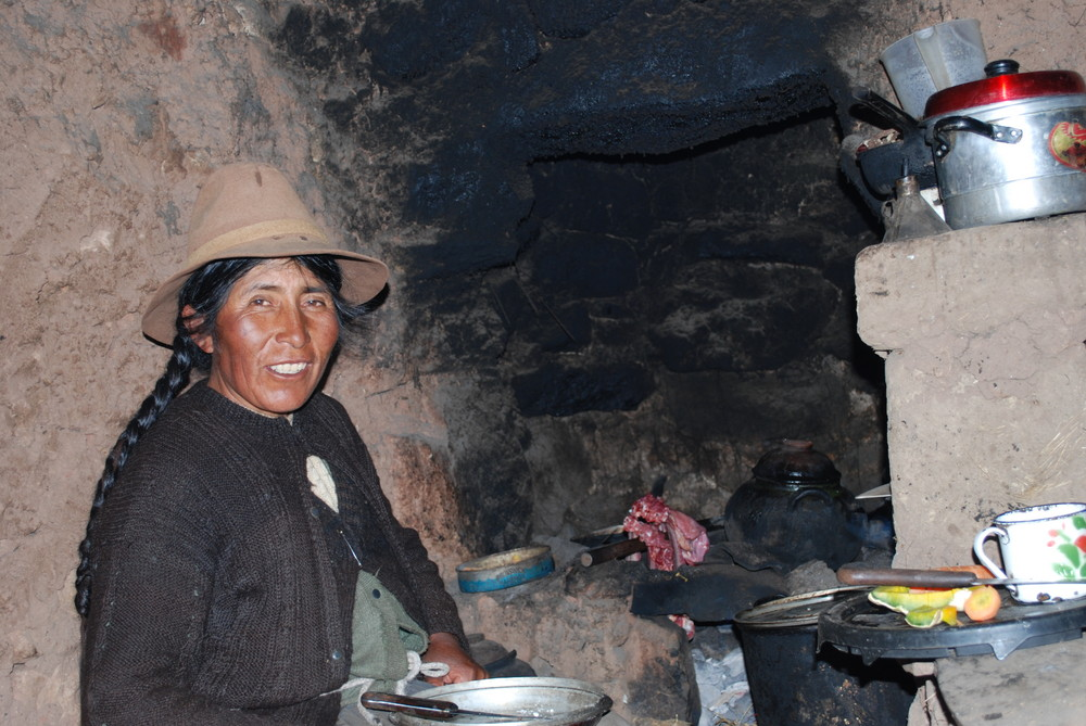 Maria in her kitchen at Puno, Peru, at 3800 meters over sea.....